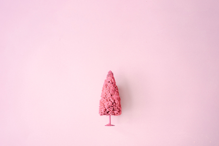 Light pink Christmas tree against pastel background. Minimal New Year concept. Imagens