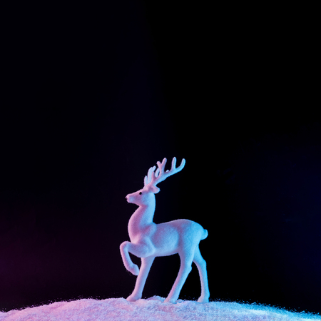 Santas reindeer on snow in vibrant bold gradient holographic colors. Christmas concept art. Minimal New Year surrealism.