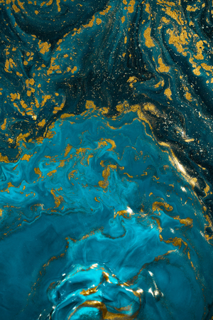 Abstract paint texture art. Natural luxury. Blue paint with gold glitter powder. Marble background.