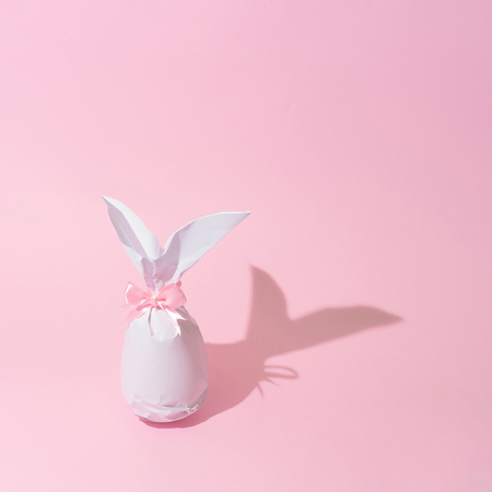 Easter bunny paper gift egg wrapping diy idea. Minimal easter pink concept pattern.