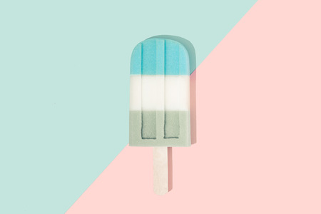 Ice cream in pastel pink on paper duotone background. Minimal summer concept. Flat lay. Imagens