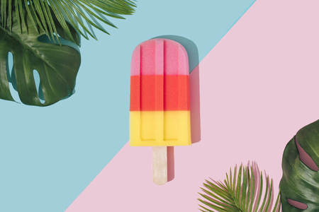 Ice cream in pastel pink on paper duotone background with tropical palm leaves. Minimal summer concept. Flat lay. Imagens