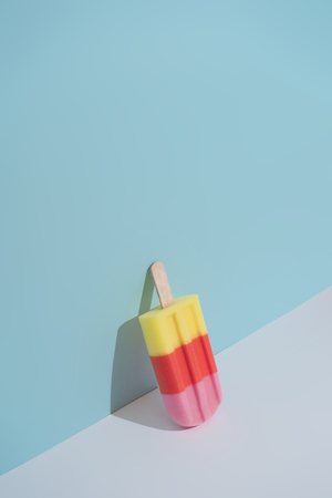 Colorful Ice cream on pastel blue background. Minimal summer composition. Imagens