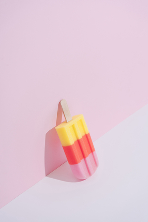 Colorful Ice cream on pastel pink background. Minimal summer composition. Imagens
