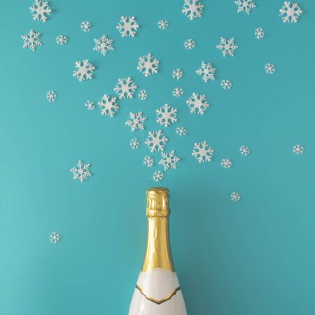 Champagne bottle with white snowflakes on bright blue background. Minimal Christmas winter party concept.
