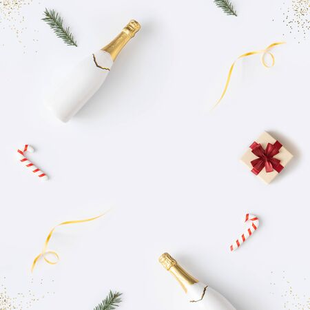 Trendy Christmas pattern made with various winter and New Year objects on bright background. Minimal Christmas concept. Standard-Bild - 135471502