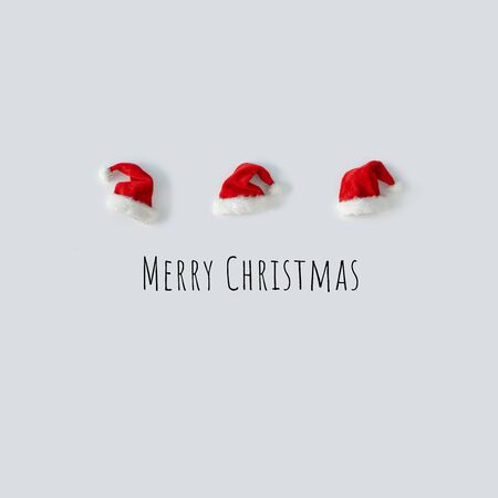 Creative Santa Claus hat with bright background. Minimal winter flat lay Christmas concept. Merry Christmas