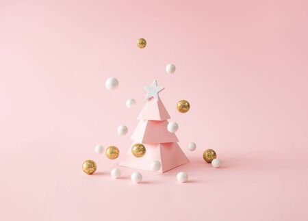 Christmas composition. Pink Christmas tree, with decoration on pink background. Happy holidays. new year minimal concept. Stock Photo
