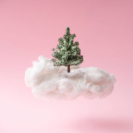 Christmas composition. Christmas tree with cloud on pink background. Happy holidays. new year minimal concept.