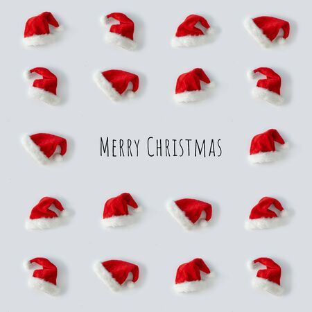 Creative Santa Claus hat pattern with bright background. Minimal winter flat lay Christmas concept. Merry Christmas