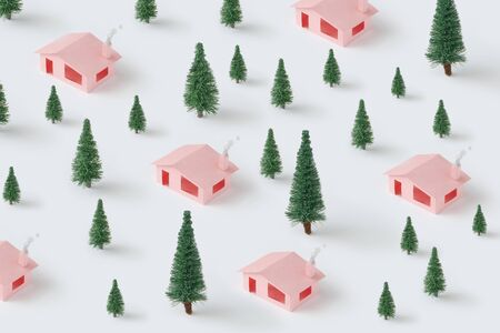 Trendy Christmas pattern made with pink houses and pine trees. Minimal winter nature concept. Standard-Bild - 135493030