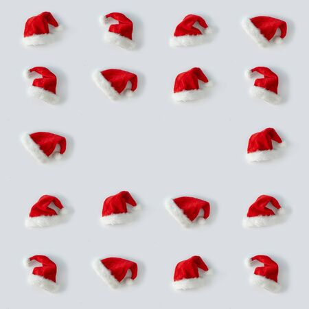 Creative Santa Claus hat pattern with bright background. Minimal winter flat lay Christmas concept.