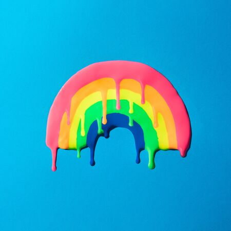 Creative minimal vivid dripping rainbow. Colorful paint background.