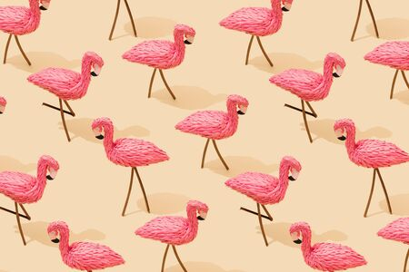 Minimal composition pattern background of pink flamingos pastel yellow. Creative summer background.