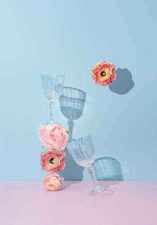 Creative natural minimal flat lay layout with flowers and champagne glasses. Mother's day or Valentines concept background design.