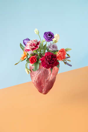 Spring flowers blooming out of a heart. Minimal love concept. Nature creative idea. 版權商用圖片