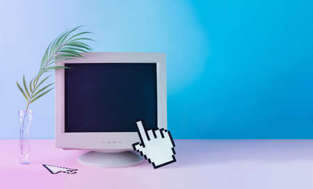 Retro vintage computer monitor with tropical palm leaf. Blue and purple colored lights. Creative minimal cyberwave background. Retro futurism.