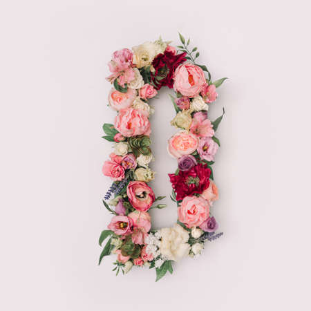 Letter D made of real natural flowers and leaves. Flower font concept. Unique collection of letters and numbers. Spring, summer and valentines creative idea.