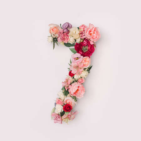 Number 7 made of real natural flowers and leaves. Flower font concept. Unique collection of letters and numbers. Spring, summer and valentines creative idea.