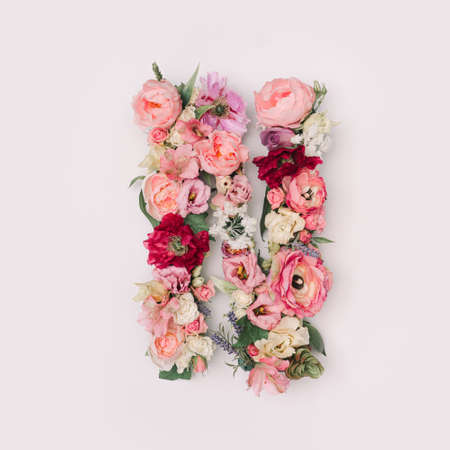 Letter N made of real natural flowers and leaves. Flower font concept. Unique collection of letters and numbers. Spring, summer and valentines creative idea. 版權商用圖片
