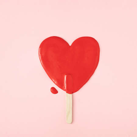 Melted icecream in shape of a heart. Minimal Valentines or love concept. Flat lay.