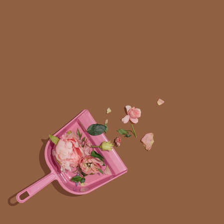 Pink dust pan with flowers and leaves. Minimal nature concept. Creative modern still life 2021.
