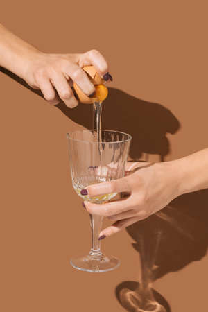 2021 Easter unique real life composition. Eggs with beautiful woman hand and champagne glass. Minimal retro style concept.