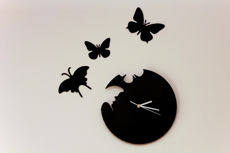 Clock with butterflys photo