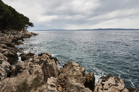 Rocks and beach near Adriatic sea in Croatia.