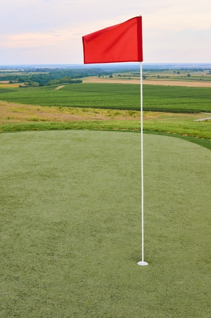 Red flag on golf terrain.