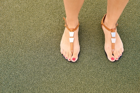 Sandals on women`s feet.