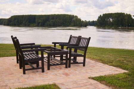 Wooden table and chairs for four people to enjoy near river Danube.