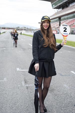 motorcars: Pit girls at V de V Endurance Series that celebrates at Circuit de Barcelona Catalunya on March 21-22, 2015 in Barcelona, Spain.