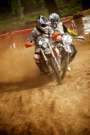 showoff: Motorbikes fighting during 24 hours endurance race of Motocross at Barcelona, Catalunya, Spain on 5 and 6 September 2015.