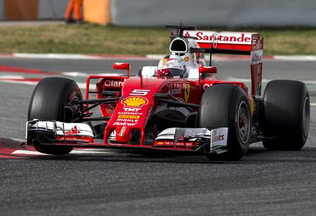 formula one: BARCELONA, SPAIN - FEBRUARY 22, 2016: Sebastian Vettel at Formula One Test Days at Catalunya Circuit on February 22, 2016 in Barcelona, Spain.