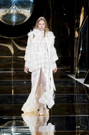 bouffant: BARCELONA, SPAIN - APRIL 27, 2016: Yolan Cris catwalk during Barcelona Bridal Fashion Week 2016.