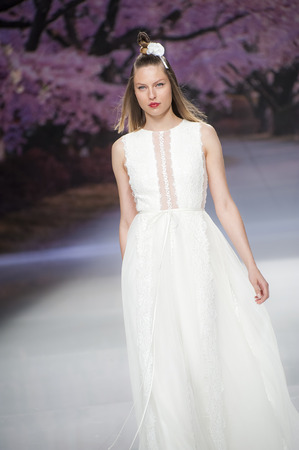 bouffant: BARCELONA, SPAIN - APRIL 27, 2016: Inmaculada Garcia catwalk during Barcelona Bridal Fashion Week 2016.