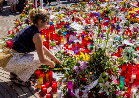 BARCELONA, SPAIN – AUGUST 22 2017: citizens laying flowers and lighting candles for victims of terrorist attack in Barcelona. Redakční