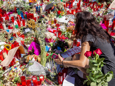 BARCELONA, SPAIN – AUGUST 22 2017: citizens laying flowers and lighting candles for victims of terrorist attack in Barcelona.