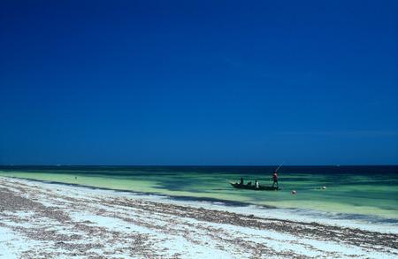 Fishermans in boat near coast in Kenya photo