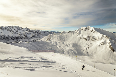 Skiing among french Alps and EURO-shaped rock on background photo