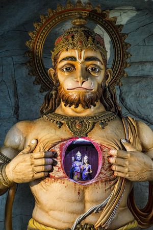 Illuminated statue of Hanuman showing Rama and Sita photo