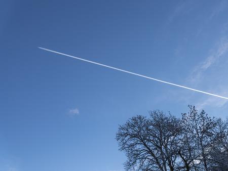contrail: Contrail in winter sky
