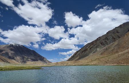 Lake among mountains photo