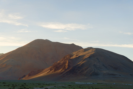 Mountain high camp at sunset photo
