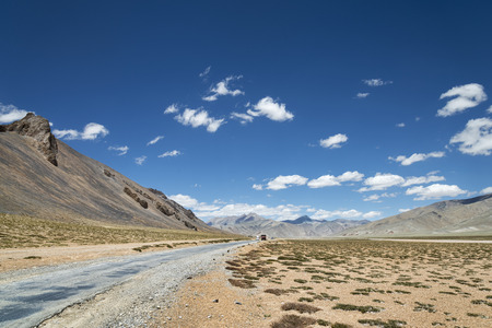 National highway among high altitude mountains photo