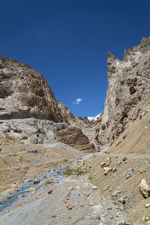 River flowing among jagged mountains photo