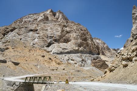 Steel construction bridge in mountains photo