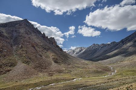 ravine: Mountain river flowing in scenic green ravine