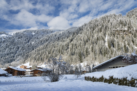 chalets: Winter Alpine landscape with mountains and chalets